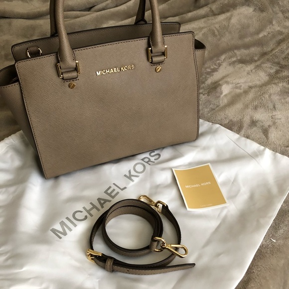 2fc09ea9658e MK Medium Selma in Dark Dune. M_5ae4d6f3739d48dfa8bdd11d. Other Bags you  may like. MICHAEL Michael Kors Cindy Large Dome Satchel